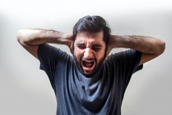 A man experienced COVID-19-related anger, fear, and anxiety.